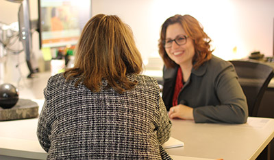 ctl employee consulting a client