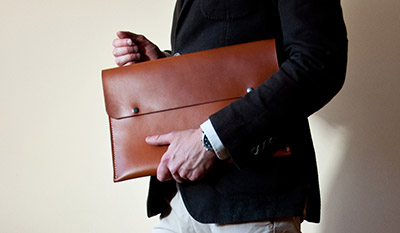 man in suit carrying a briefcase
